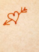 Heart with arrow drawn in ketchup