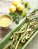 Grilled asparagus with orange and cashew nut dressing