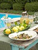 Aubergine & chick-pea salad, fresh lemons & sparkling wine punch by pool