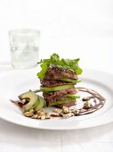 Slices of beef fillet with avocado, Gorgonzola and rocket