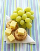 Crackers with cheese and grapes