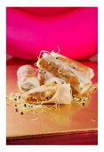 Rice paper rolls filled with butter chicken, onion and sprouts