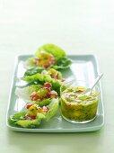 Prawns on lettuce leaves with mango salsa
