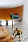 Toy football player, crackers and beer