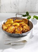 Apple and potato rösti in frying pan