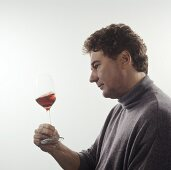 Swirling glass of wine: oxygenating, checking consistency