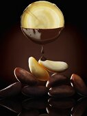 Brazil nuts and slices of horseradish dipped in chocolate