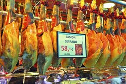 Serrano ham on a market stall (Mercat de St. Josep (Boqueria), Las Ramblas, Barcelona, Spain)