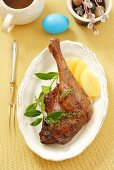 Glazed goose leg with marinated pears for Easter