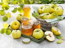 Freshly picked quinces and quince jelly