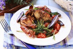 Rabbit with ceps, bacon and cherry tomatoes