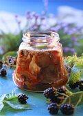Pickled forest mushroom salad in screw-top jar