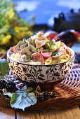 Pasta salad with tomatoes and mushrooms