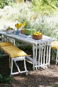 Outdoor picnic with crockery on DIY table made from wooden poles