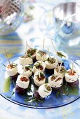 Soft cheese and grapes on cocktail sticks