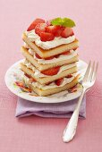 Tower of sponge, strawberries and cream