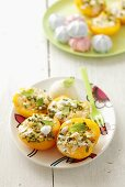 Baked peaches stuffed with meringue and pistachios