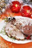 Slices of roast pork with sauce (Christmas)