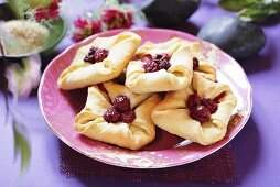 Curd cheese turnovers with cherries