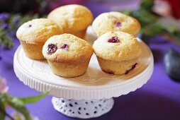 Cranberry muffins on cake stand