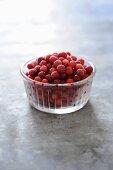 Frozen cranberries in glass dish
