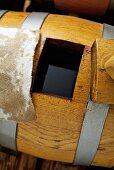 Balsamic vinegar maturing in wooden barrel