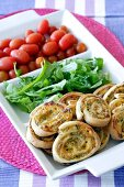 Pizza pinwheels with lettuce and tomatoes