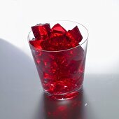 Red jelly cubes in a glass