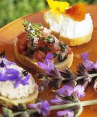 Three canapés with edible flowers