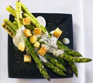 Grilled green asparagus with Caesar salad dressing