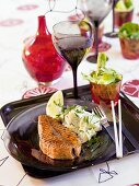 Grilled salmon cutlet with potato salad