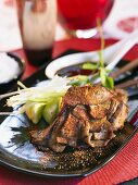 Grilled meat with Chinese seasoning and cucumber salad