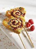 Heart-shaped raspberry cake lollipops
