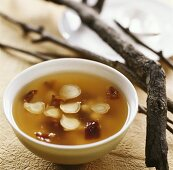 Raw fish soup with ginseng and dates