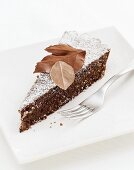 A piece of chocolate tart with chocolate leaves