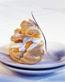 Profiterole with cream and mandarin oranges
