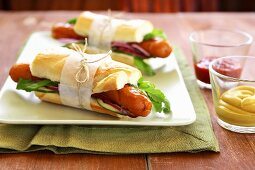 Baguettes filled with sausages, rocket and salad