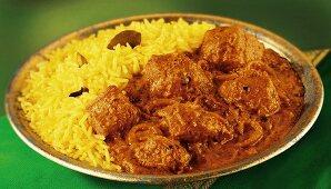 Indian chicken tikka masala with saffron rice