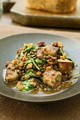Lentil stew with ceps and sausages