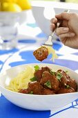 Ribbon pasta with meatballs and tomato sauce