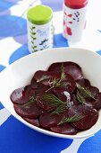 Pickled beetroot slices with dill