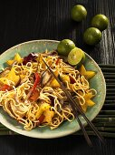 Asian egg noodles with pork and star fruit