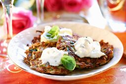 Cereal and vegetable rosti with sour cream