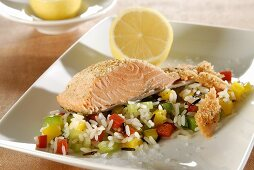 Salmon trout fillet on peppers and rice