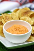 Red pepper dip with potato crisps