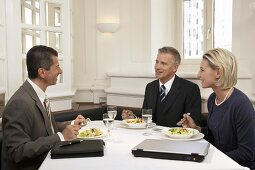 Business people meeting for lunch in a restaurant