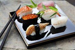 Nigiri sushi with salmon, salmon caviar, tuna, eel, prawn and sea bream