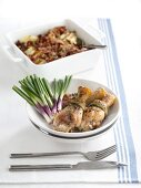 Roasted chicken legs with spring onions and fried potatoes