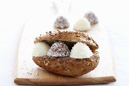 A bread roll filled with coconut sweets