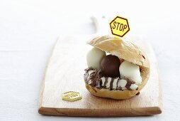 A bread roll filled with chocolate marshmallows and topped with a stop sign